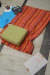 Τα χαρακτηριστικά του εγχειρήματος: βιβλίο Οδύσσειας, μαξιλαράκια και πετσέτες για να καθόμαστε και αυτοσχέδιες ανακοινώσεις.
